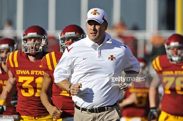 Head coach Paul Rhoads of the Iowa State Cyclones takes the field with his team before the game against the Oklahoma State Cowboys at Jack Trice...