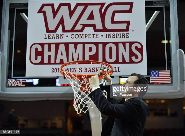 Head coach Paul Weir of the New Mexico State Aggies cuts down a piece of a net following the team's 7060 win over the Cal State Bakersfield...