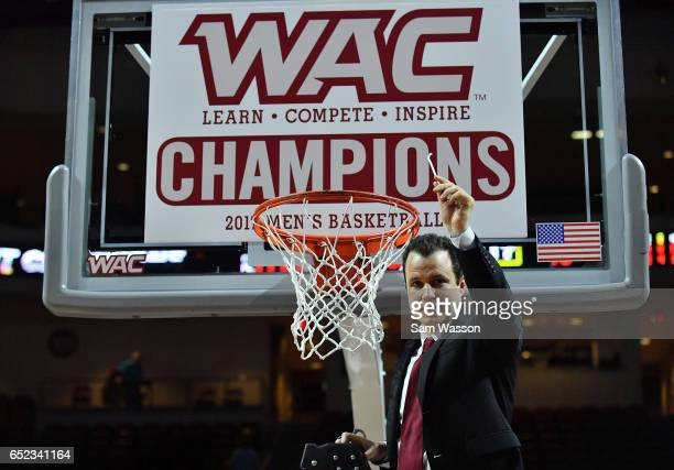 Head coach Paul Weir of the New Mexico State Aggies reacts after cutting down a piece of a net following the team's 7060 win over the Cal State...
