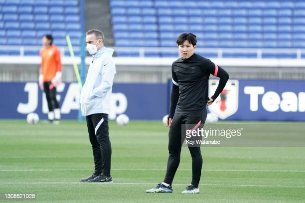 Head coach Paulo Bento and Lee Kangin of South Korea are seen during a training session ahead of the international friendly match between Japan and...