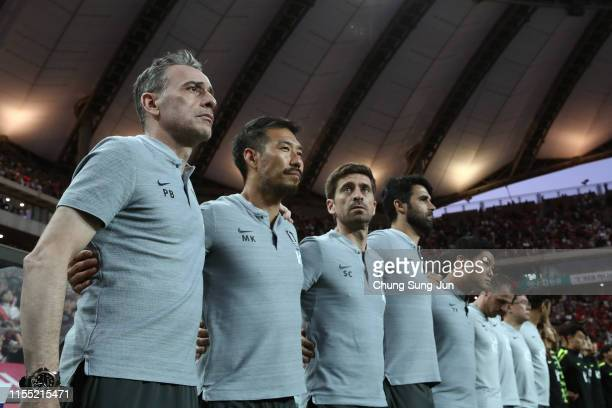 Head coach Paulo Bento and team staffs line up for the national anthems prior to the international friendly match between South Korea and Iran at...