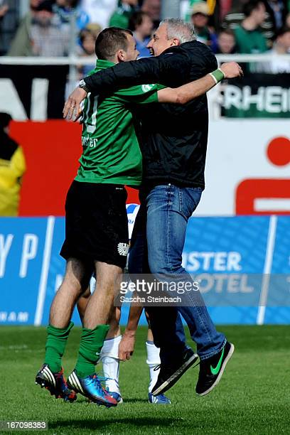 Head coach Pavel Dotchev of Muenster celebrates the victory over Karlsruhe after the 3. Liga match between Preussen Muenster and Karlsruher SC at...