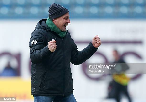 Head coach Pavel Dotchev of Muenster jubilates after his team scoring the second goal during the third league match between FC Hansa Rostock and...