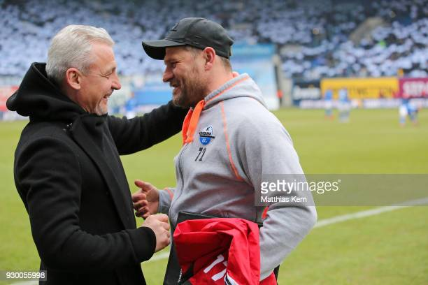 Head coach Pavel Dotchev of Rostock and head coach Steffen Baumgart of Paderborn look on prior to the 3Liga match between FC Hansa Rostock and SC...