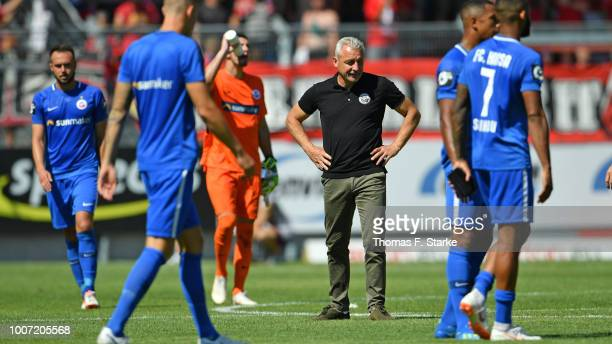 Head coach Pavel Dotchev of Rostock looks dejected after the 3. Liga match between FC Energie Cottbus and F.C. Hansa Rostock at Stadion der...