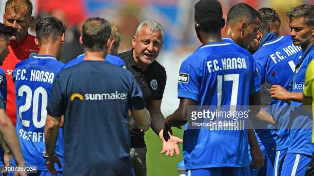 Head coach Pavel Dotchev of Rostock speaks to his players during the 3. Liga match between FC Energie Cottbus and F.C. Hansa Rostock at Stadion der...