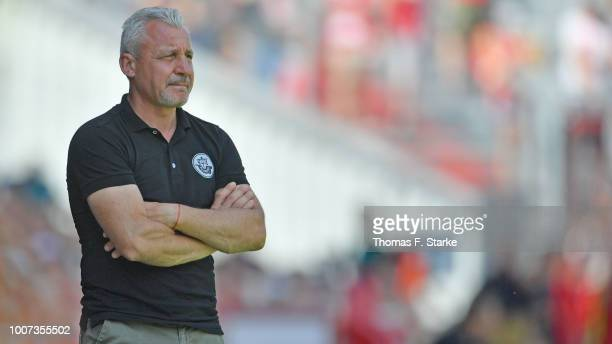 Head coach Pavel Dotchev of Rostock watches his players during the 3. Liga match between FC Energie Cottbus and F.C. Hansa Rostock at Stadion der...