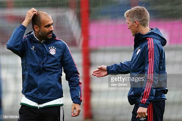 Head coach Pep Guardiola and Bastian Schweinsteiger discuss during a Bayern Munich training session ahead of their UEFA Champions League Group D...