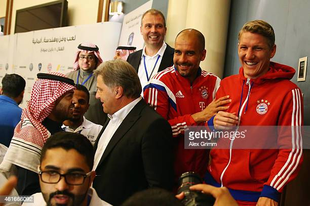 Head coach Pep Guardiola and Bastian Schweinsteiger of Muenchen leave a press conference prior to the friendly match between Al Hilal and Bayern...