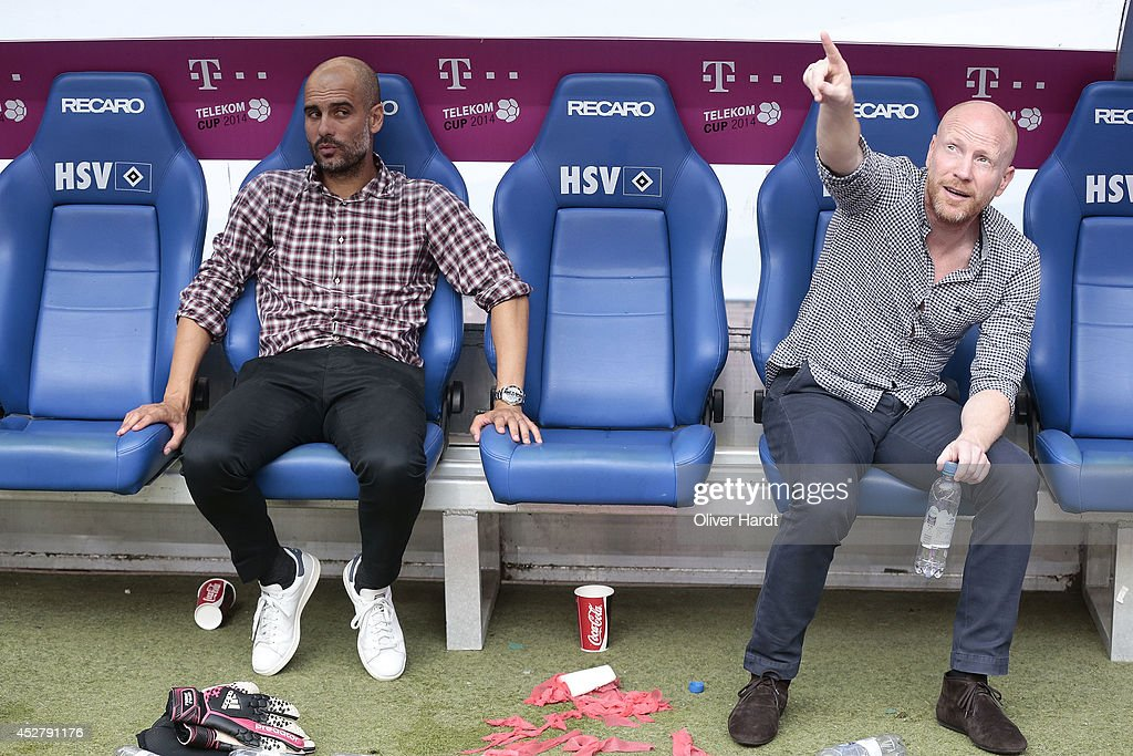 Head coach Pep Guardiola and Matthias Sammer (L-R) of Munich after the Telekom Cup 2014 Finale match between FC Bayern Muenchen and Borussia Moenchengladbach at Imtech Arena on July 27, 2014 in Hamburg, Germany.