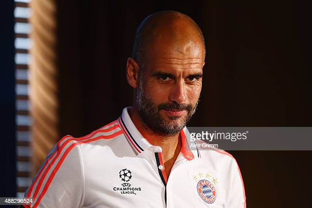 Head coach Pep Guardiola arrives for a Bayern Muenchen press conference ahead of their UEFA Champions League Group F match against Olympiacos FC at...