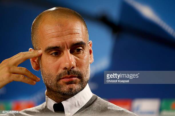 Head coach Pep Guardiola attends a press conference ahead of the UEFA Champions League match between Borussia Moenchengladbach and Manchester City at...