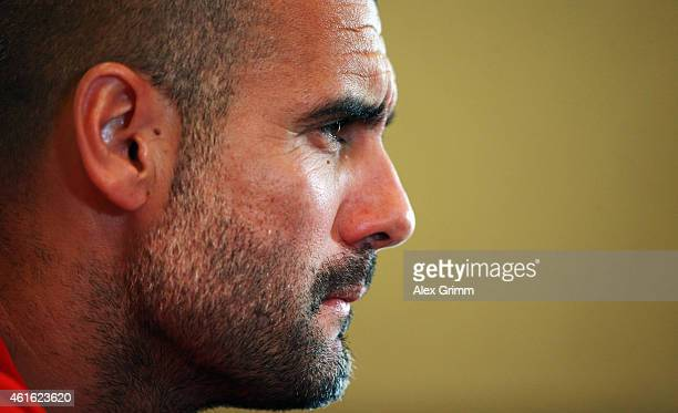 Head coach Pep Guardiola attends a press conference during day 8 of the Bayern Muenchen training camp at ASPIRE Academy for Sports Excellence on...