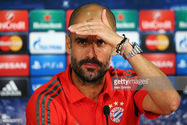 Head coach Pep Guardiola attends the FC Bayern Muenchen press conference ahead of their UEFA Champions League Group E match against Manchester City...