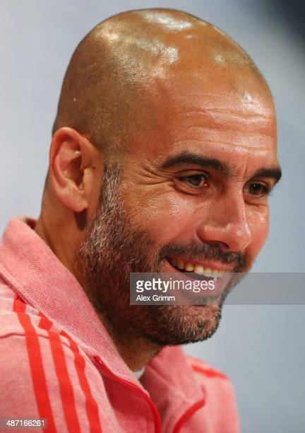 Head coach Pep Guardiola attends the FC Bayern Muenchen press conference ahead of their UEFA Champions League semifinal second leg match against Real...