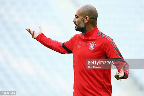 Head coach Pep Guardiola attends the FC Bayern Muenchen training session ahead of their UEFA Champions League Group E match against Manchester City...