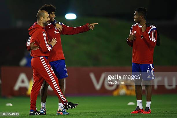 Head coach Pep Guardiola Dante and David Alaba chat during day 2 of the Bayern Muenchen training camp at ASPIRE Academy for Sports Excellence on...