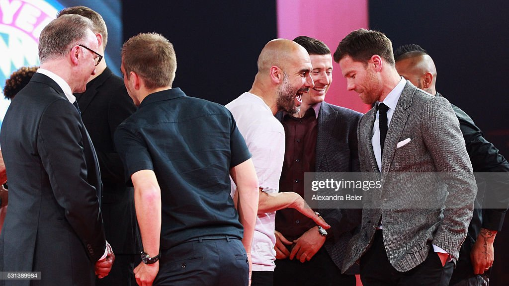 Head Coach, Pep Guardiola has a laugh with Xabi Alonso on stage after they receive their Championshop rings during the FC Bayern Muenchen Bundesliga Champions Dinner at the Postpalast on May 14, 2016 in Munich, Bavaria.