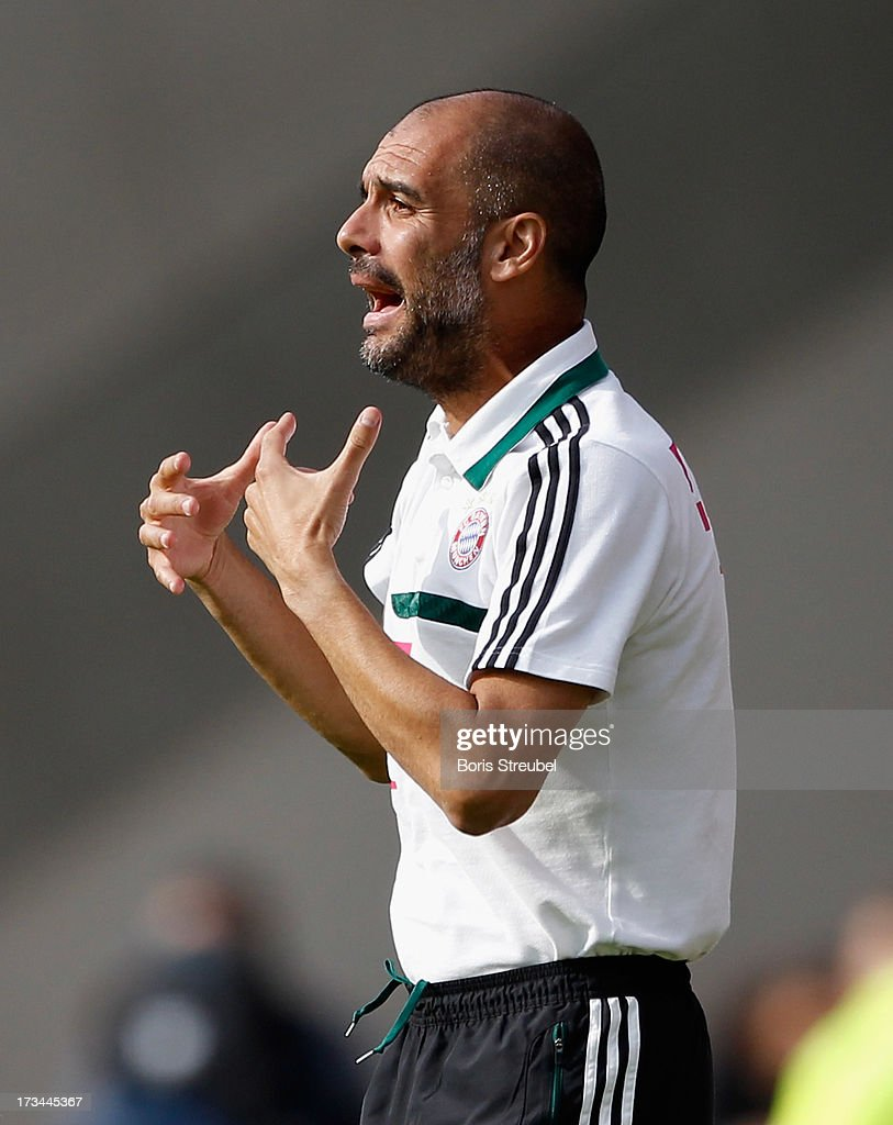 Head coach Pep Guardiola of Bayern Muenchen gestures during the the charity match between Hansa Rostock and FC Bayern Muenchen at DKB-Arena on July 14, 2013 in Rostock, Germany.