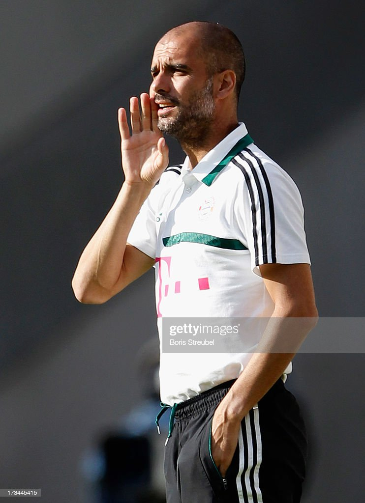Head coach Pep Guardiola of Bayern Muenchen issues instructions during the the charity match between Hansa Rostock and FC Bayern Muenchen at DKB-Arena on July 14, 2013 in Rostock, Germany.