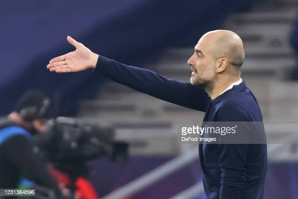 Head coach Pep Guardiola of Manchester City gestures during the UEFA Champions League Round of 16 match between Borussia Moenchengladbach and...