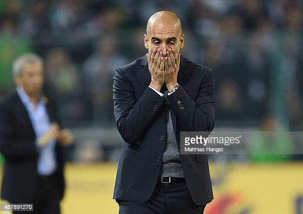 Head coach Pep Guardiola of Muenchen reacts during the Bundesliga match between Borussia Moenchengladbach and FC Bayern Muenchen at Borussia Park on...
