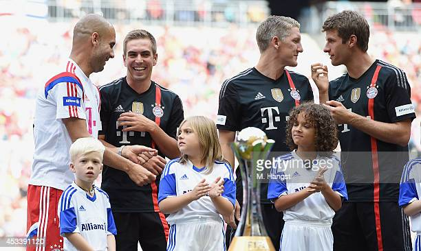 Head coach Pep Guardiola on Muenchen Philipp Lahm of Muenchen Bastian Schweinsteiger and Thomas Mueller of Muenchen joke during the FC Bayern...