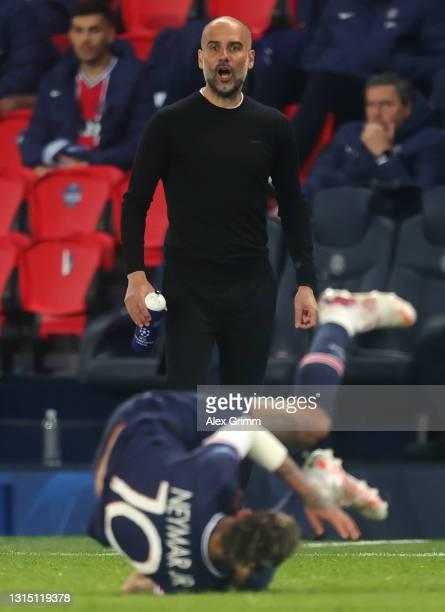 Head coach Pep Guardiola reacts during the UEFA Champions League Semi Final First Leg match between Paris Saint-Germain and Manchester City at Parc...