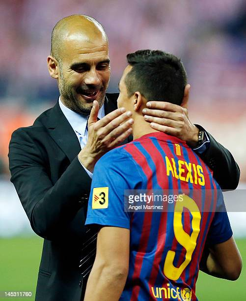 Head coach Pepe Guardiola of Barcelona embraces Alexis Sanchez after their victory in the Copa del Rey Final match between Athletic Bilbao and...