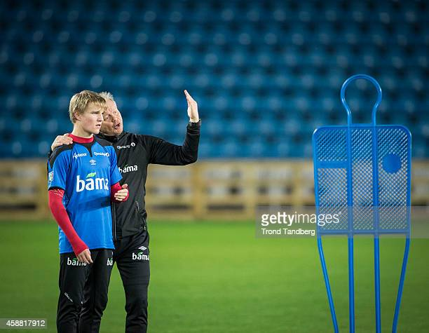 Head Coach PerMathias Hoegmo provides instructions to Martin Odegaard of Norway during the Norway training session at Ullevaal Stadion on November 11...