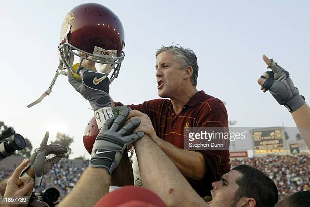 Head coach Pete Carroll addresses his team while being given a victory ride after their victory over UCLA on November 23, 2002 at the Rose Bowl in...