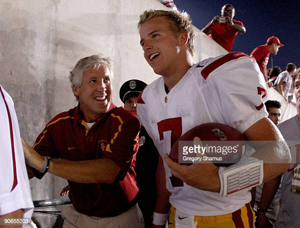 Head coach Pete Carroll and Matt Barkley of the Southern California Trojans leave the field after defeating the Ohio State Buckeyes 18-15 on...