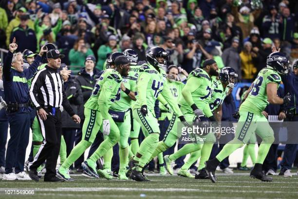 Head coach Pete Carroll and players of the Seattle Seahawks celebrate a blocked field goal by Bobby Wagner in the fourth quarter against the...