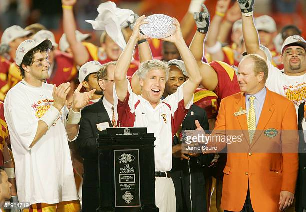 Head coach Pete Carroll and quarterback Matt Leinart of the USC Trojans celebrate with the championship trophy after defeating the Oklahoma Sooners...
