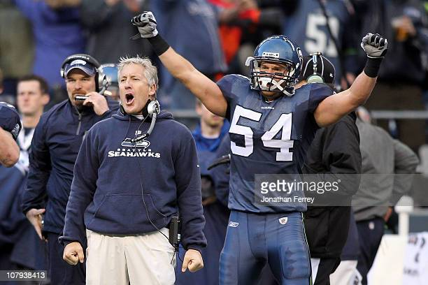Head coach Pete Carroll and Will Herring of the Seattle Seahawks celebrate a fourth down stop by the Seahawks in the third quarter against the New...
