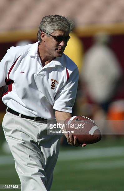 Head Coach Pete Carroll catches a pass during the warm ups before the game against Colorado State University at the Los Angeles Coliseum in Los...