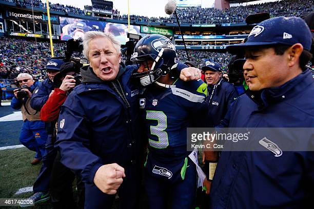 Head coach Pete Carroll celebrates with Russell Wilson of the Seattle Seahawks after the 2015 NFC Championship game against the Green Bay Packers at...