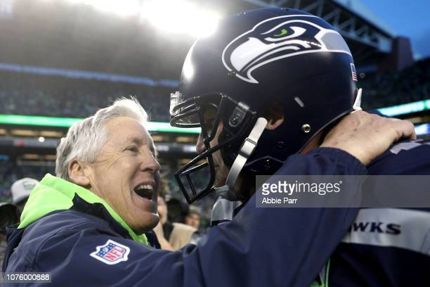 Head Coach Pete Carroll celebrates with Sebastian Janikowski of the Seattle Seahawks after kicking a 33 yard field goal to defeat the Arizona...