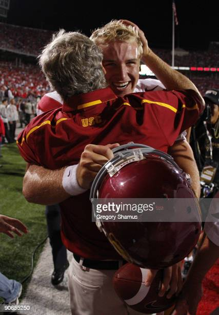 Head coach Pete Carroll hugs Matt Barkley of the Southern California Trojans after defeating the Ohio State Buckeyes 18-15 on September 12, 2009 at...