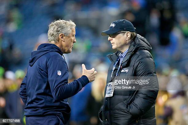 Head coach Pete Carroll left of the Seattle Seahawks speaks with Seahawks owner Paul Allen before an NFL game against the Carolina Panthers at...