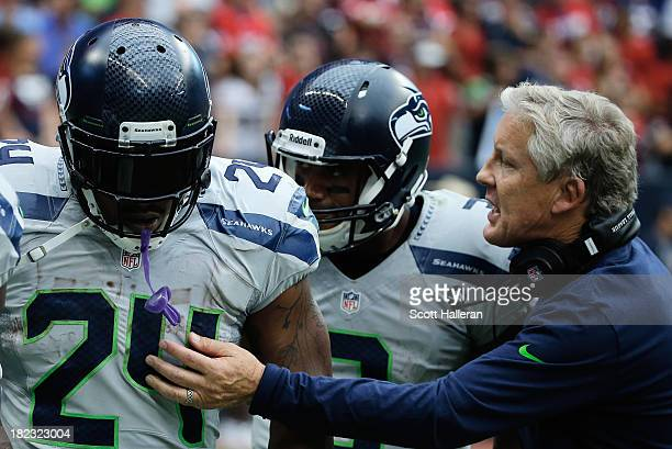 Head coach Pete Carroll of the Seattle Seahawks celebrates a touchdown in the second half by Marshawn Lynch against the Houston Texans at Reliant...