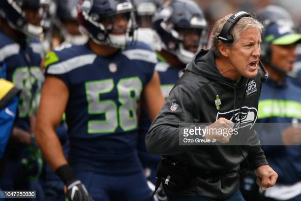 Head Coach Pete Carroll of the Seattle Seahawks celebrates a score in the first half against the Los Angeles Rams at CenturyLink Field on October 7...