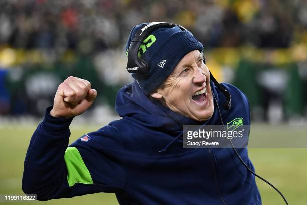 Head coach Pete Carroll of the Seattle Seahawks celebrates after a touchdown during the second half against the Green Bay Packers in the NFC...