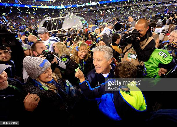 Head coach Pete Carroll of the Seattle Seahawks celebrates with his wife Glena and family after their 438 victory over the Denver Broncos during...