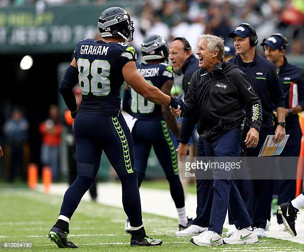 Head coach Pete Carroll of the Seattle Seahawks celebrates with Jimmy Graham in the fourth quarter against the New York Jets at MetLife Stadium on...