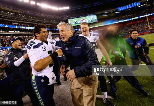 Head coach Pete Carroll of the Seattle Seahawks celebrates with quarterback Russell Wilson after winning Super Bowl XLVIII at MetLife Stadium on...