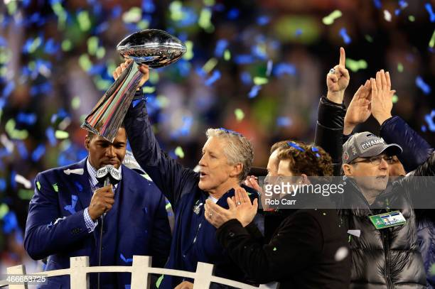 Head coach Pete Carroll of the Seattle Seahawks celebrates with the Vince Lombardi Trophy after their 43-8 victory over the Denver Broncos during...