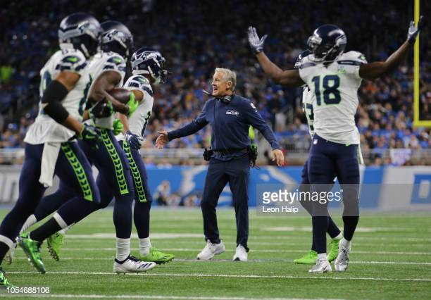 Head coach Pete Carroll of the Seattle Seahawks comes onto the field to celebrate his teams second touchdown against the Detroit Lions during the...