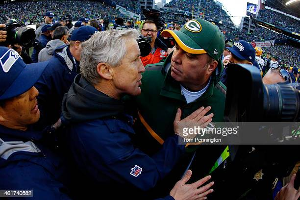 Head coach Pete Carroll of the Seattle Seahawks greets head coach Mike McCarthy of the Green Bay Packers after the Seahawks won the 2015 NFC...