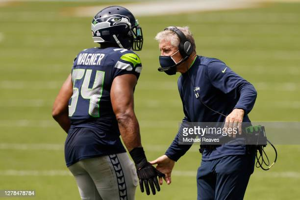 Head coach Pete Carroll of the Seattle Seahawks high fives Bobby Wagner against the Miami Dolphins during the first quarter at Hard Rock Stadium on...
